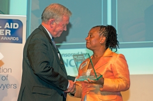 Doreen Lawrence presents district judge Nick Crichton with the Outstanding Achievement award 2010